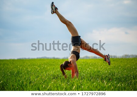 A man does a gymnastic handstand in the gym  Stock photo © dacasdo