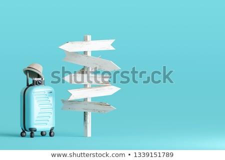 tourist sign post and suitcases stock photo © 4designersart