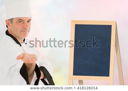 Male chef presenting an invisible product  Stock photo © wavebreak_media