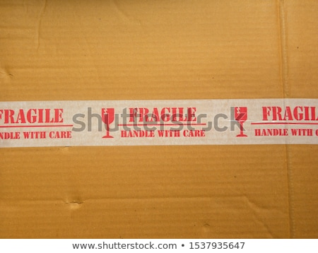 grunge color  fragile symbol on cardboard Stock photo © Kheat