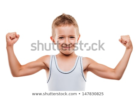 Stockfoto: Smiling Sport Child Boy Showing Hand Biceps Muscles Strength