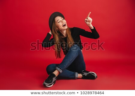 stylish young woman pointing away stock photo © stockyimages