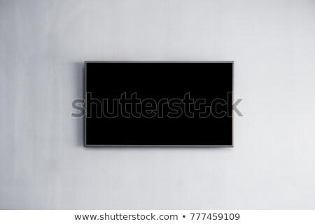Led tv hanging monitor on the wall background Stock photo © robuart