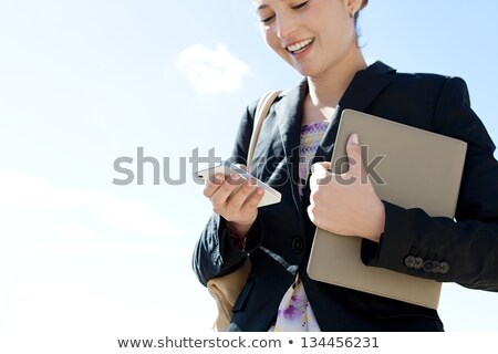 Young woman smiling while holding a blue folder Stock photo © stryjek