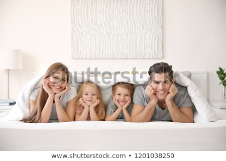 family in bed Stock photo © ongap