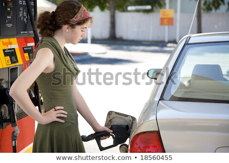 woman at gas station filling up her car stock photo © ichiosea