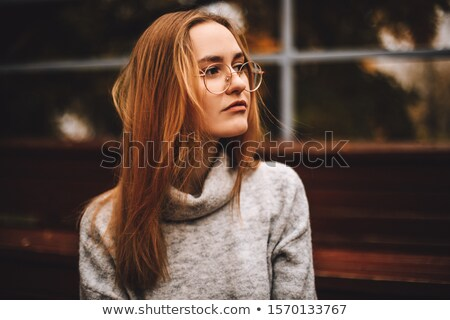 Pensive young woman with long blond hair  Stock photo © Nejron