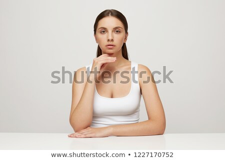Young Woman with Hair Pulled Back and Hand on Chin Stock photo © dash