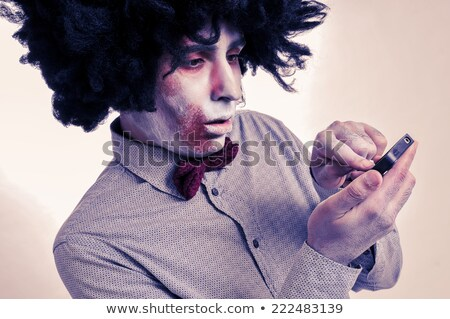 scary zombie using a smartphone Stock photo © nito