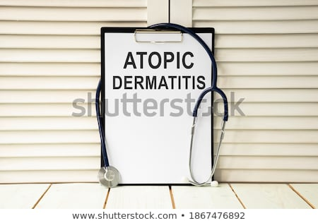 eczema on the display of medical tablet stock photo © tashatuvango
