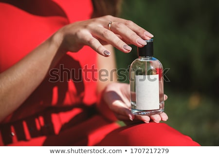 female hand with perfume stock photo © nyul