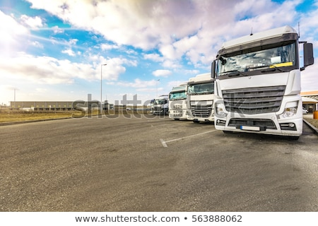 White Semi Trailer Truck on a Warehouse Yard stock photo © tainasohlman