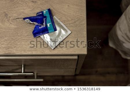 dollar banknotes and condom Stock photo © nito