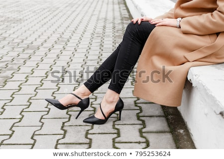 Cold woman in an elegant black and white outfit Stock photo © juniart