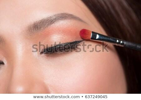 Pretty Woman Applying Eye Shadow Makeup Stock photo © juniart