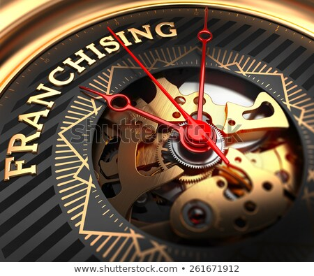 Franchising on Black-Golden Watch Face. Stock photo © tashatuvango