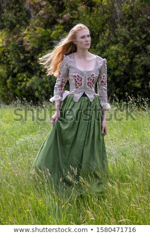 Attractive young woman in green corset  Stock photo © Elisanth