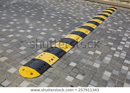 Traffic safety speed bump on an asphalt road Stock photo © art9858