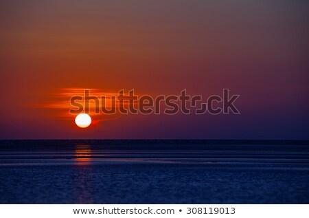 Orange Ball of the Sun Dipping towards Horizon at Sunset Stock photo © pzaxe