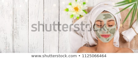 young beautiful woman applying a mask for the face of the therap stock photo © dashapetrenko