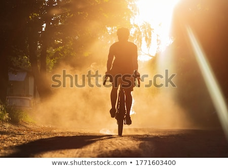 Riding in dust Stock photo © FOTOYOU