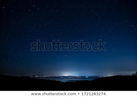 Csillagos éjszakai város tájkép város természet csillagok Stock fotó © OleksandrO