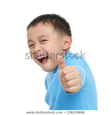 Portrait of little cute boy giving the thumbs-up sign Stock photo © zurijeta