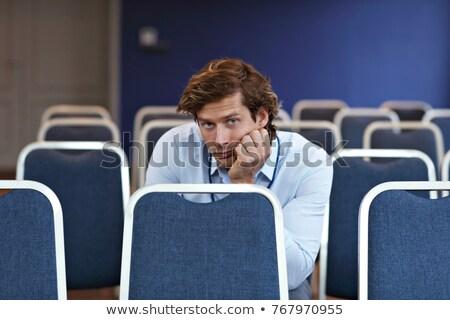человека сидят конференции зале случайный Сток-фото © deandrobot