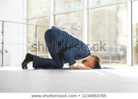Muslim man praying on the mat Stock photo © bluering