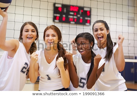 A Caucasian girl playing volleyball Stock photo © bluering