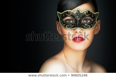 Cute woman in masquerade mask Stock photo © artfotodima