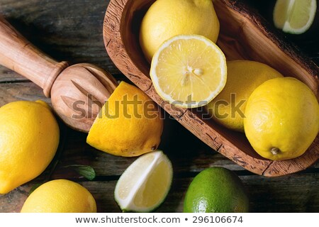Whole lime and wooden citrus reamer Stock photo © sarahdoow
