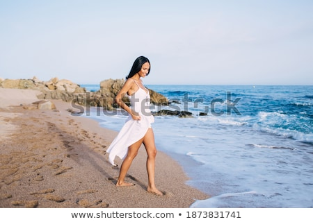 Cute trendy young woman on a tropical promenade Stock photo © dash