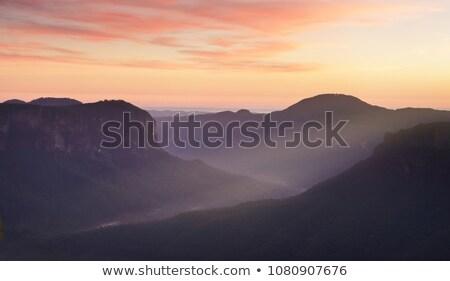 Látványos kő kék hegyek hajnal észak Stock fotó © lovleah