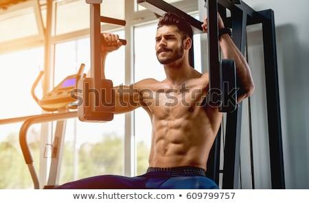 Férfi képzés mellkas sajtó felszerlés oldalnézet Stock fotó © LightFieldStudios