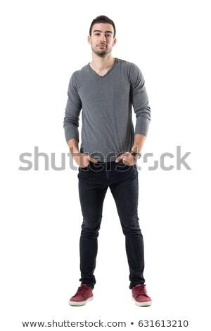 jovem · caucasiano · sério · homem · em · pé · isolado - foto stock © deandrobot