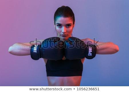 Nő boxkesztyűk mozgás lövés fekete testmozgás Stock fotó © LightFieldStudios