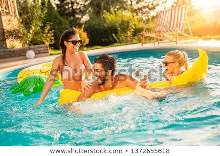 Szczęśliwy kobieta bikini strój kąpielowy krawędź basen Zdjęcia stock © dolgachov