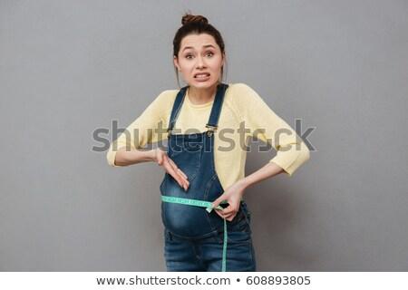 Mulher grávida em pé isolado centímetro foto Foto stock © deandrobot