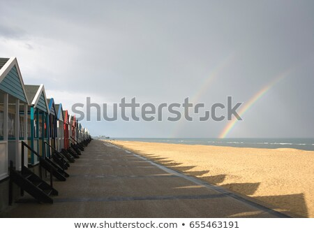 Beach huts with double rainbow Stock photo © IS2