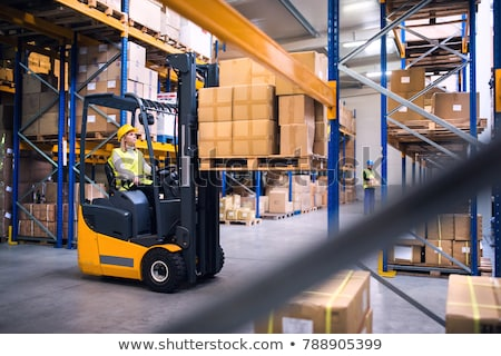 Stok fotoğraf: Lifting Boxes With Forklift