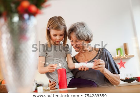 grandchild and grandma with candle Stock photo © IS2