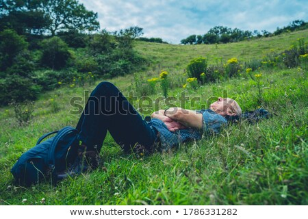 Senior man lying in meadows Stock photo © IS2