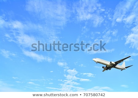 white passenger aircraft in blue sky stock photo © ssuaphoto