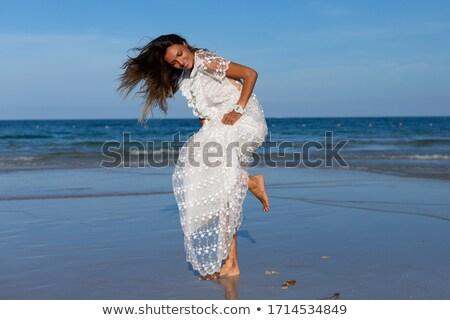 kobieta · biała · sukienka · podniesionymi · rękami · spaceru · niebieski - zdjęcia stock © dash