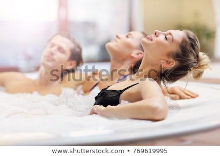 Glimlachende vrouw hot tub glimlachend geluk luxe vergadering Stockfoto © IS2