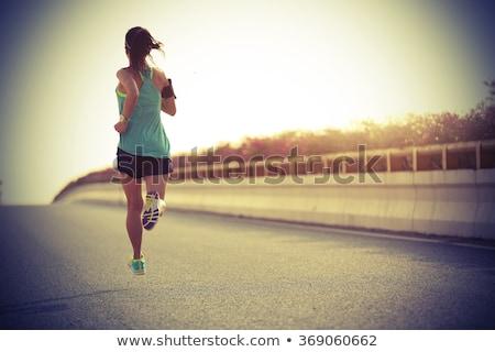 woman running on city street at seaside stock photo © blasbike