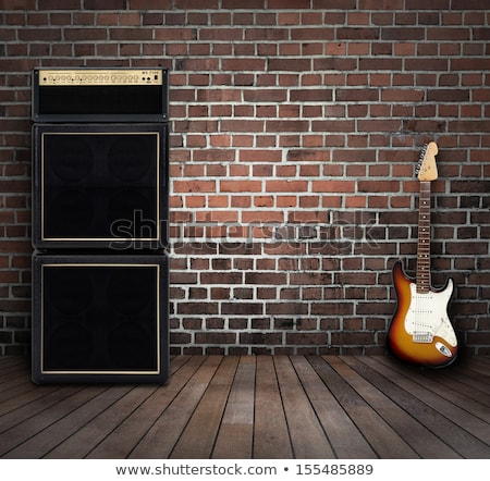 electric guitar and amplifier on a brick wall background stock photo © tracer