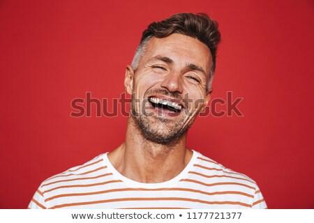 Jóképű fickó borosta csíkos póló nevet Stock fotó © deandrobot