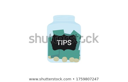 Isolated jar filled with coins labeled Donations Stock photo © Zerbor
